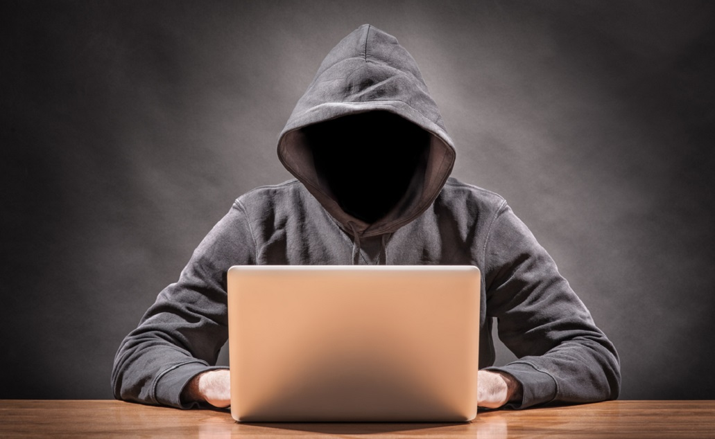 masked man on laptop_cyber security